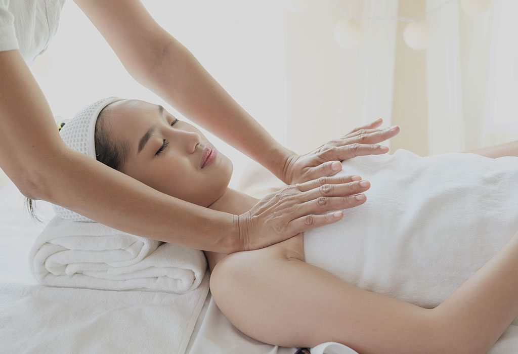 A woman getting a breast massage