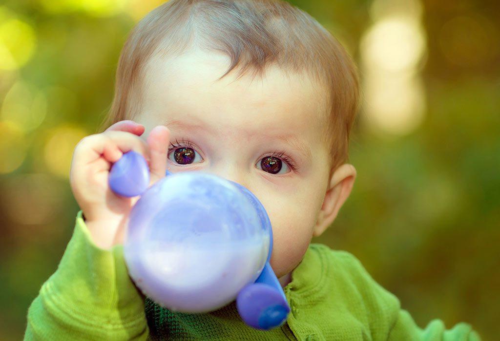 Baby drinking raw milk
