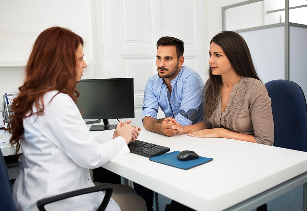 Couple discussing with doctor