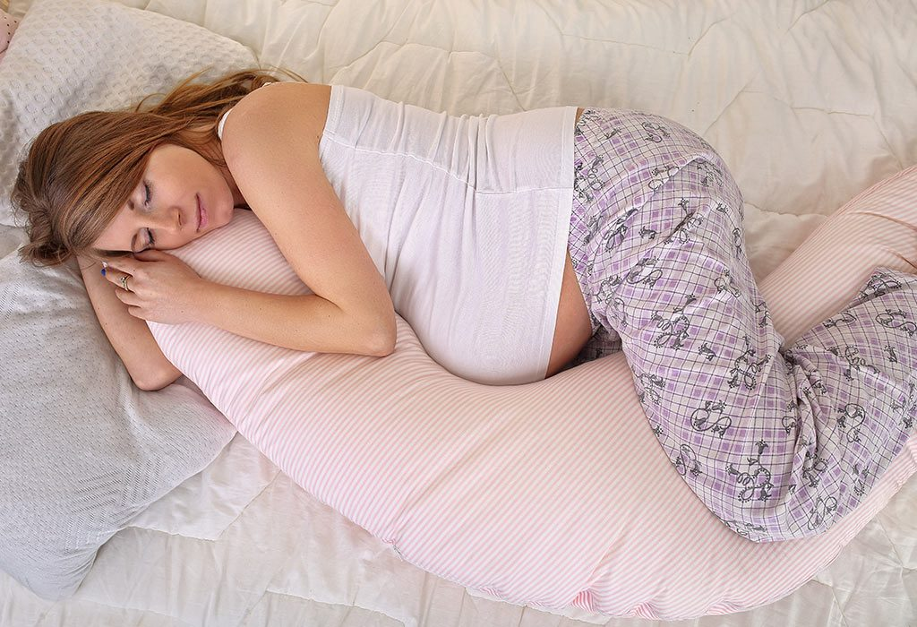 A pregnant woman sleeping