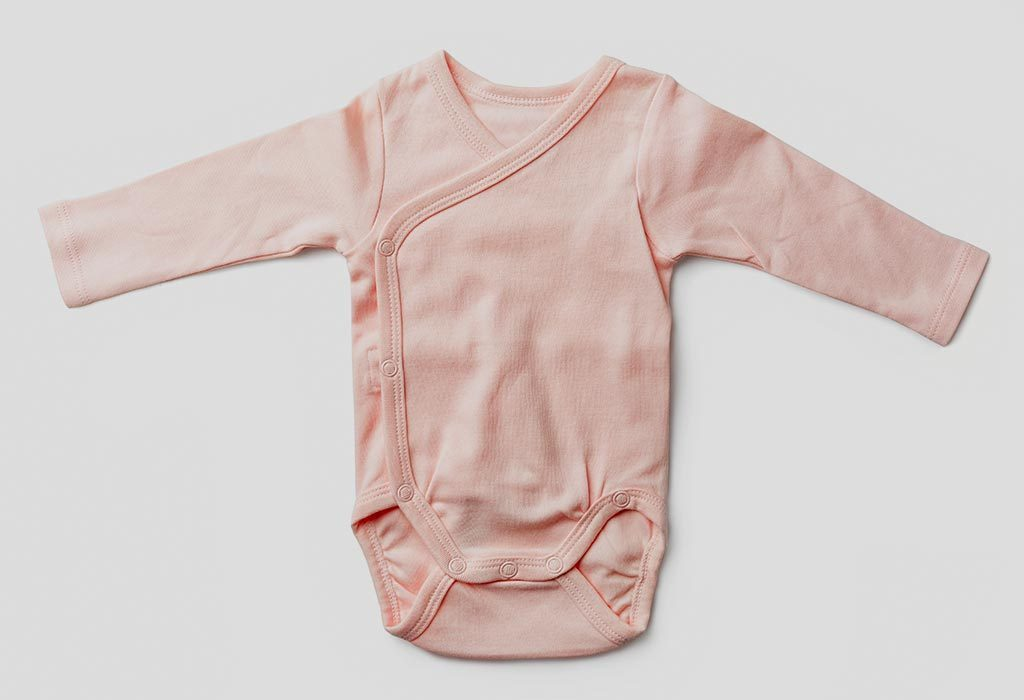 Peach-coloured bodysuit for a baby