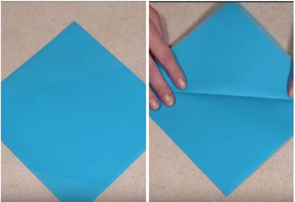 Take a square of paper and fold the left point over the right point to create a crease diagonally.