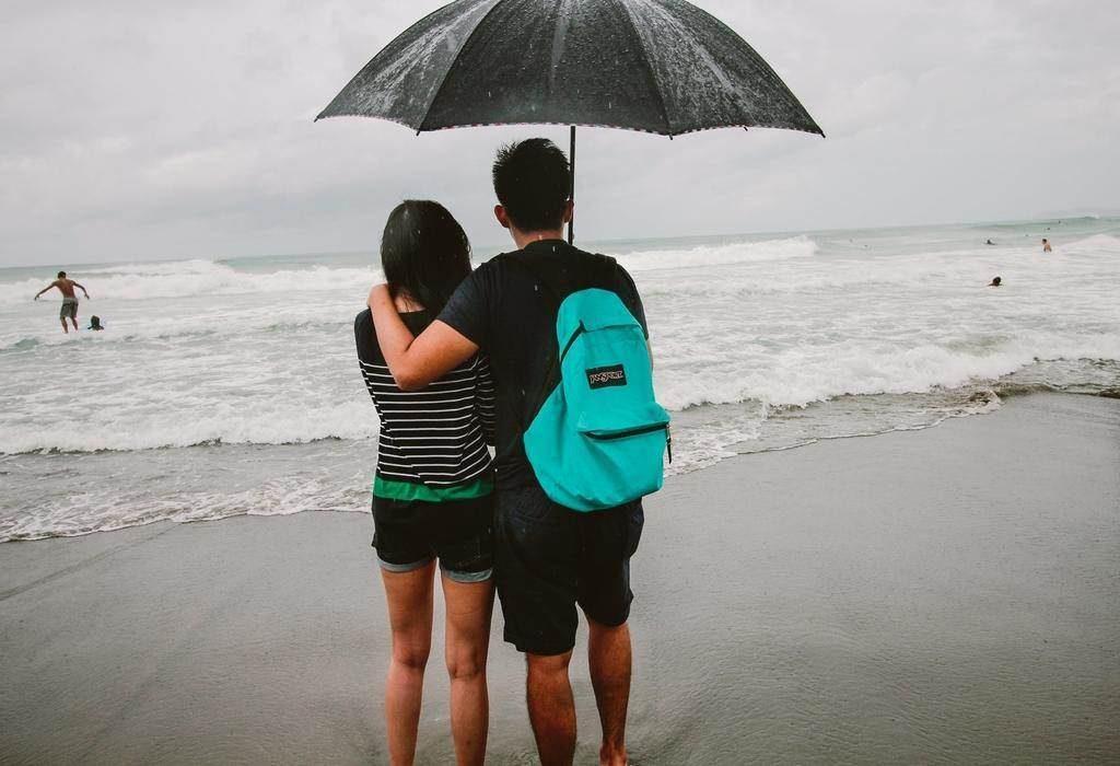 couple walking on seashore