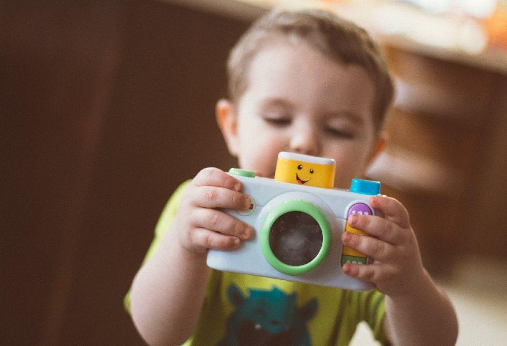 Child holding toy