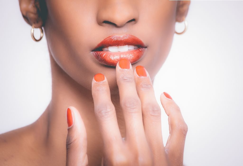 woman showing nail colours