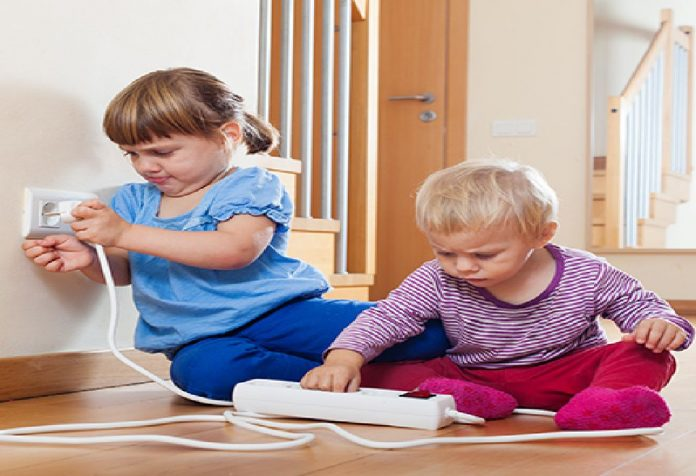 toddlers turning switches on and off