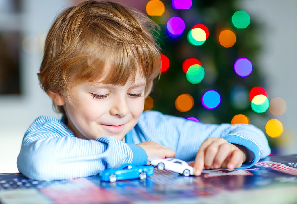 Boy playing with toy-cars