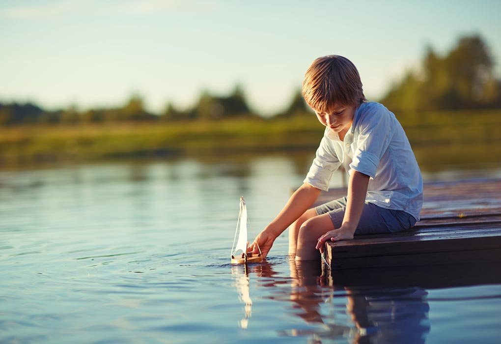 Boy playing with a toy-boat