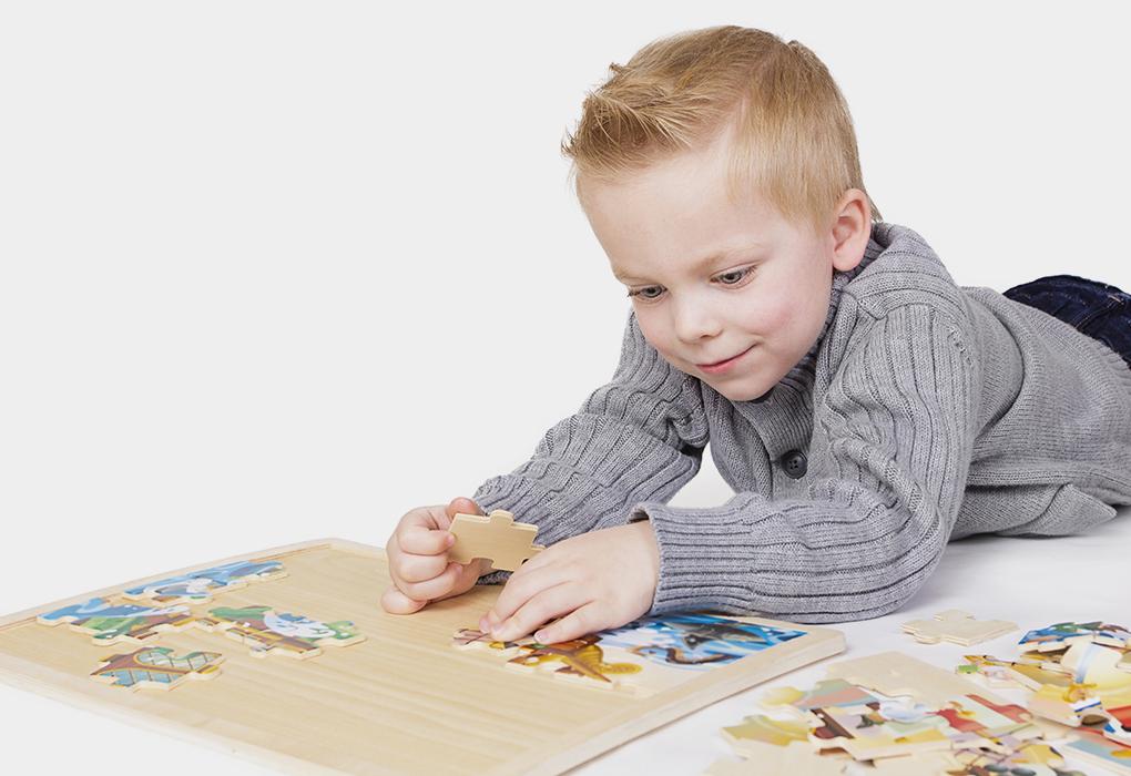 A boy solving a puzzle
