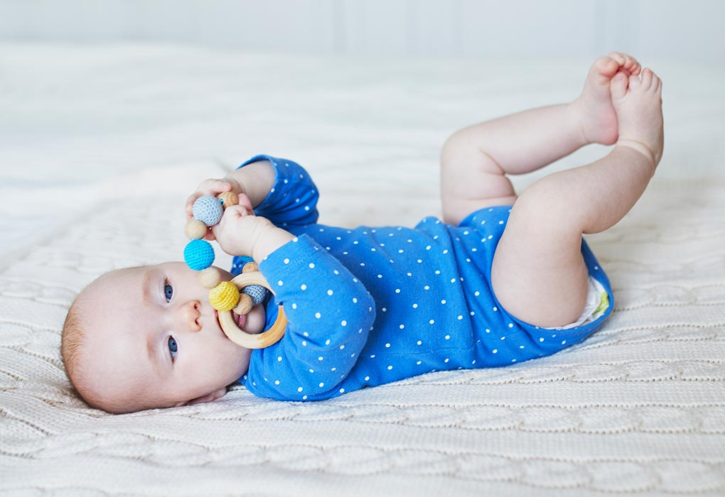 4-month-old holding toys