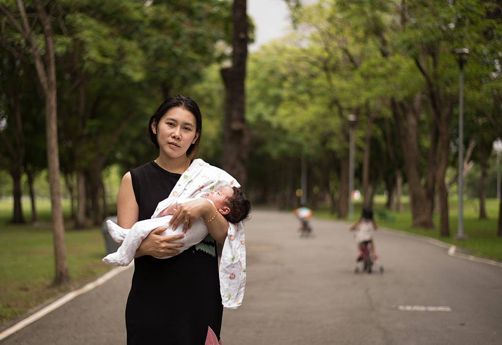 A mother taking her1-month-oldd baby in a park