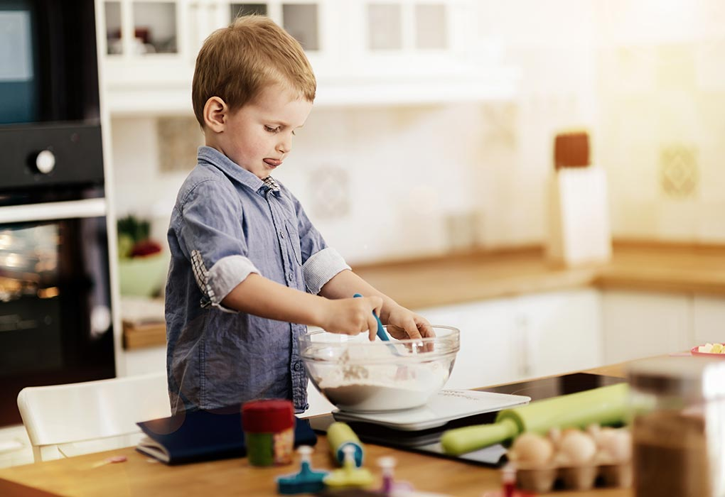 A boy making cookies