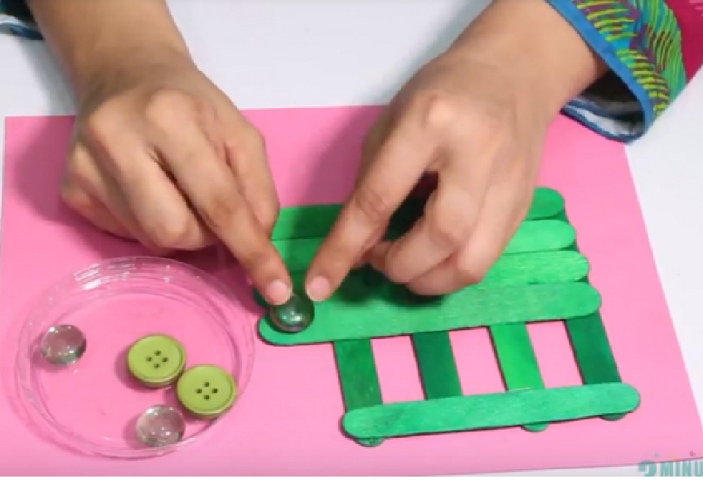 Glue the buttons/crystals on the sticks to decorate the bus.