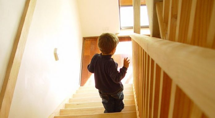 helping toddler walk up the stairs