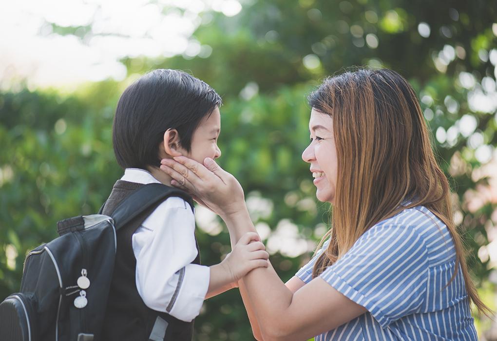 Child saying goodbye