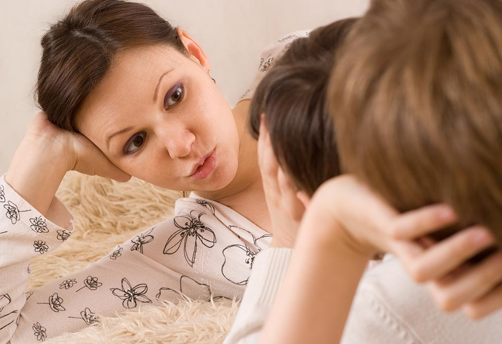 Mom talking to child calmly