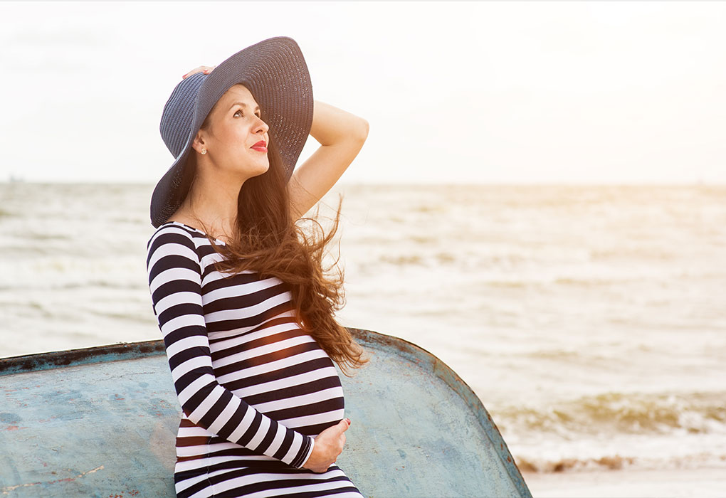 A pregnant woman on a boat