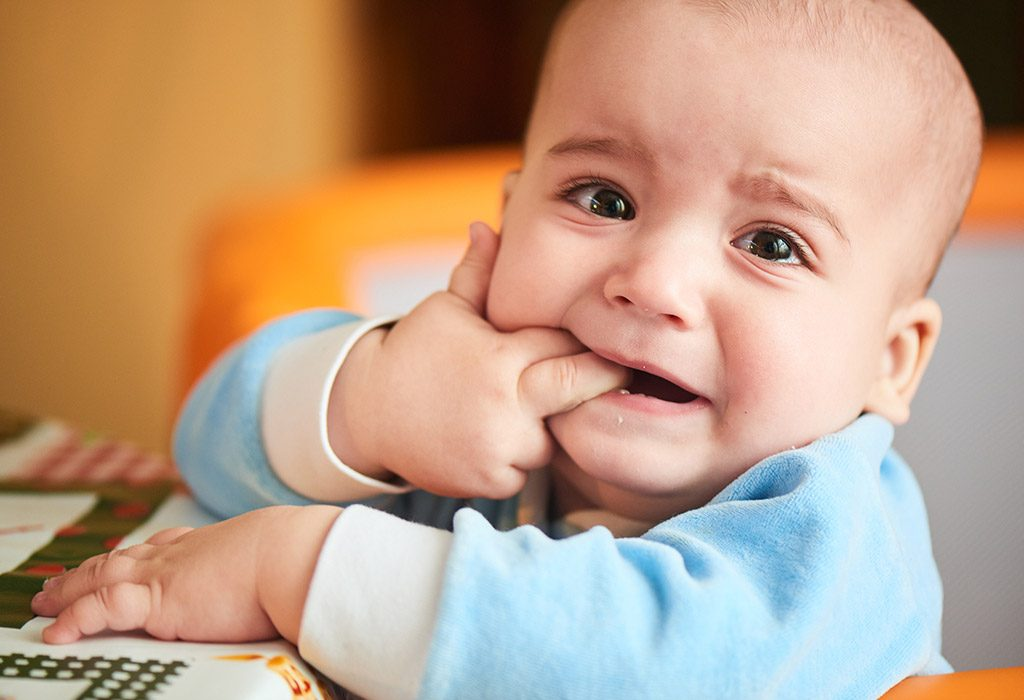 A baby with teething pain