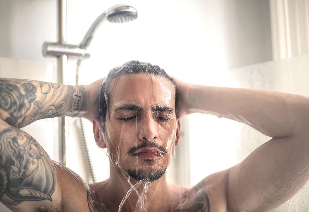 Handsome man taking a bath