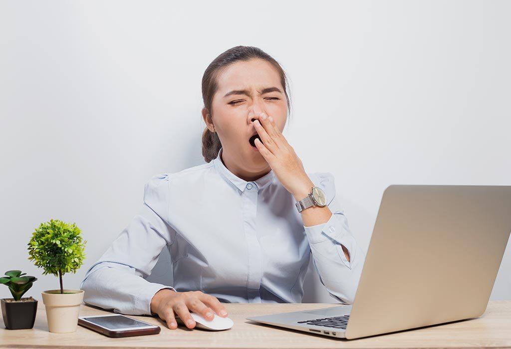A woman sleepy in office