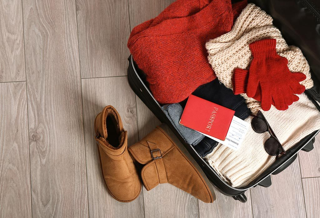 Winter clothes packed in a suitcase
