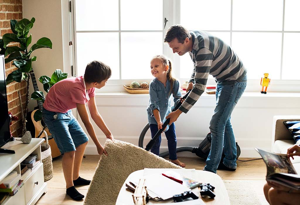 A father cleans his house with his kids