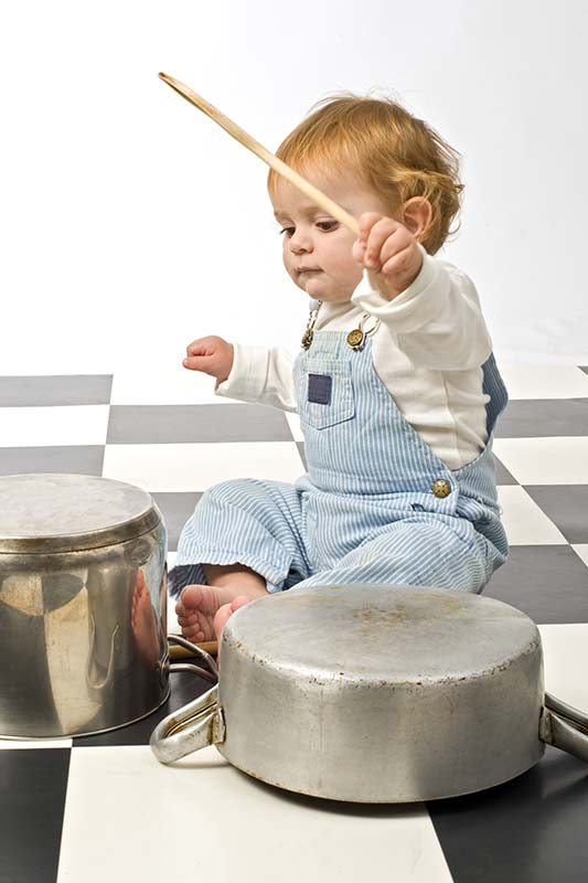 Child Playing with Pots and Pans