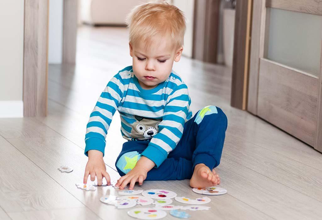 A child solving a puzzle