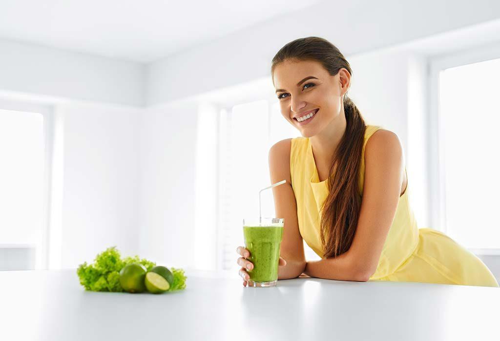 A woman drinking fruit juice