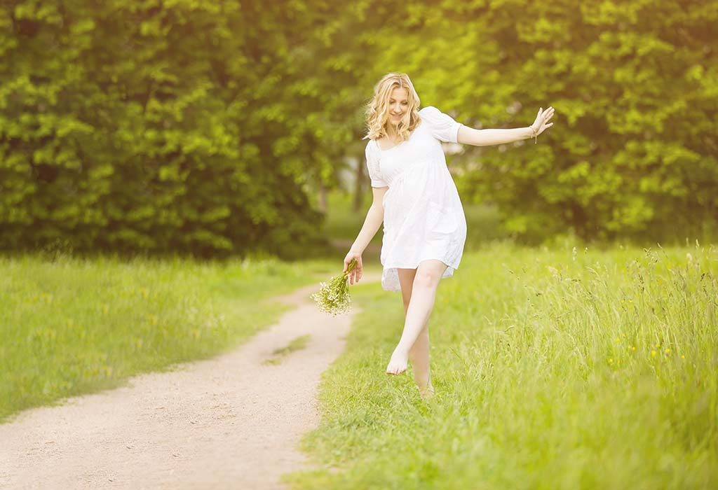 Happy Pregnant Woman Walking Barefoot