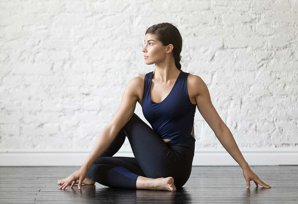 Half spinal twist pose for Kidney stones