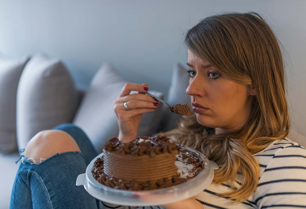 A woman eating a cake
