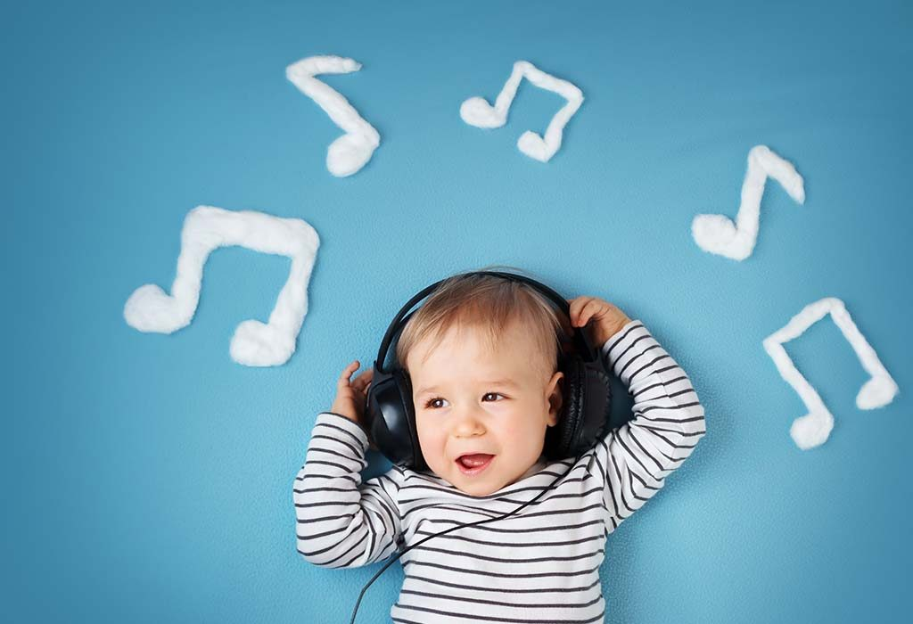 A baby boy listening to music