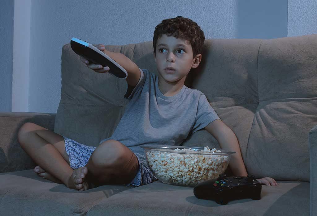 A boy watching a movie