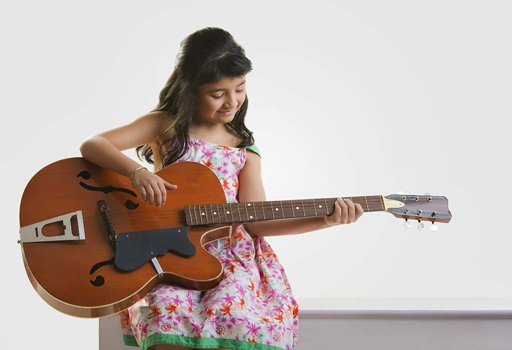 Girl Playing the Guitar by Herself