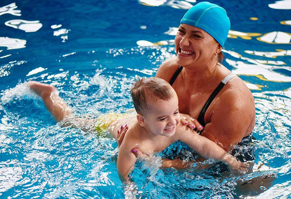 Mother & child swimming together