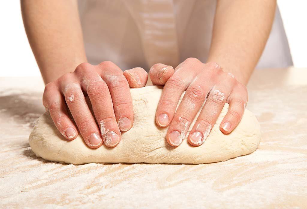 A woman kneading the dough
