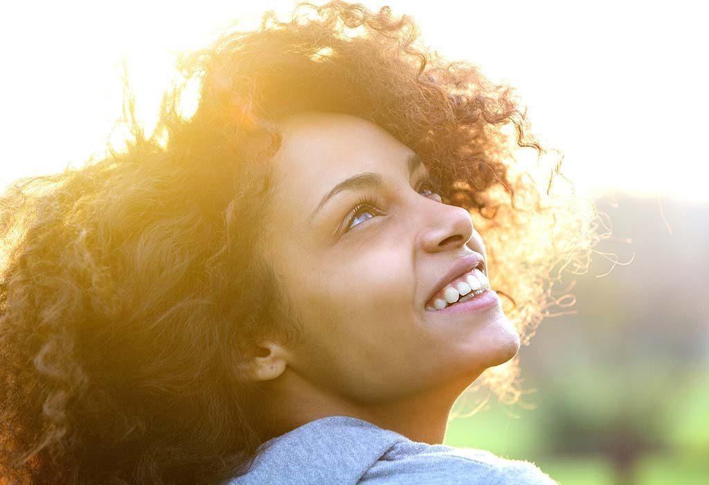 woman staring at sunlight