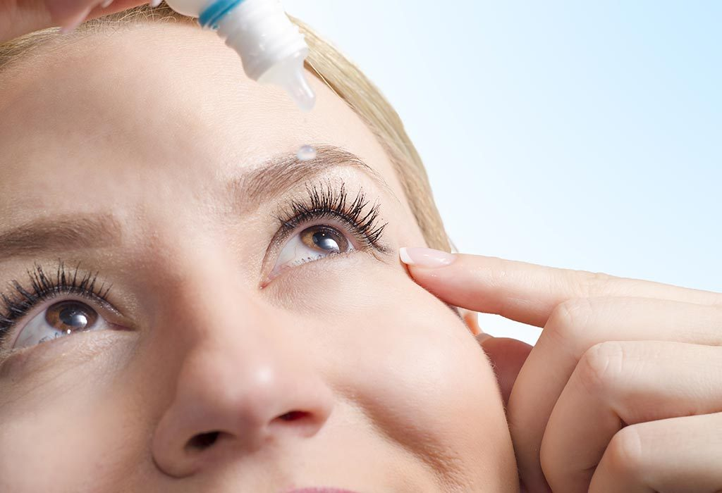 A woman using eye drops