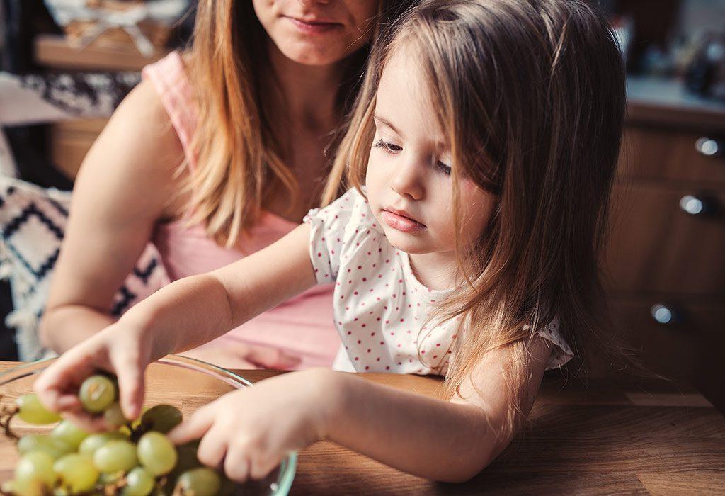 Toddler eating fruits