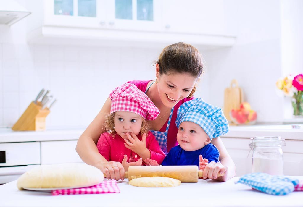 Toddlers cooking with mom