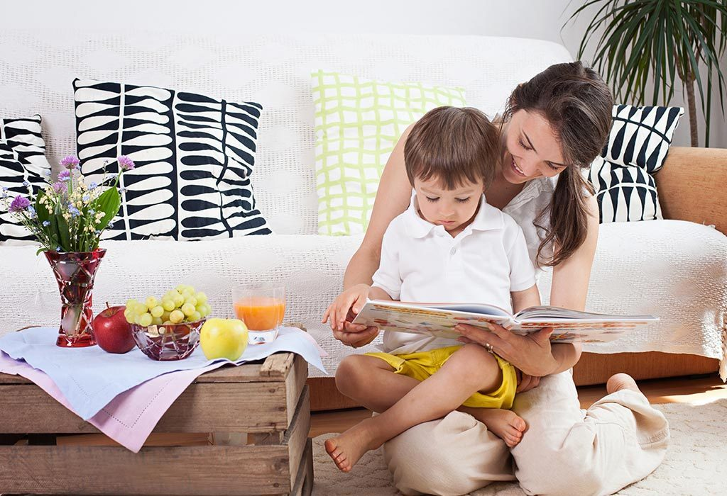 A mother reading to her toddler