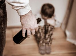 boy frightened of drunk father