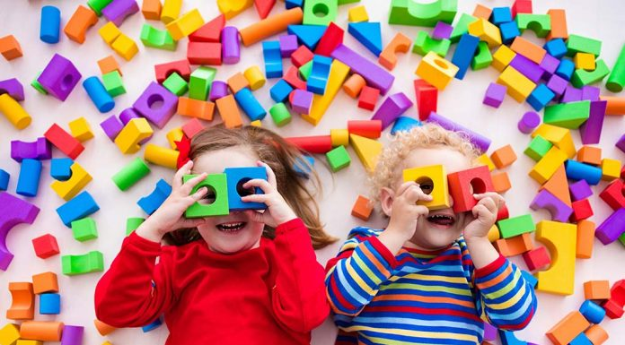 kids playing with colourful shapes