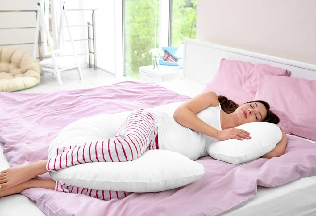 A pregnant woman using a pillow for support