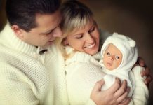 parents and baby enjoying winter