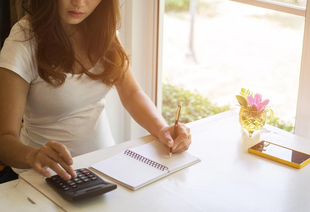 A pregnant woman planning her finances