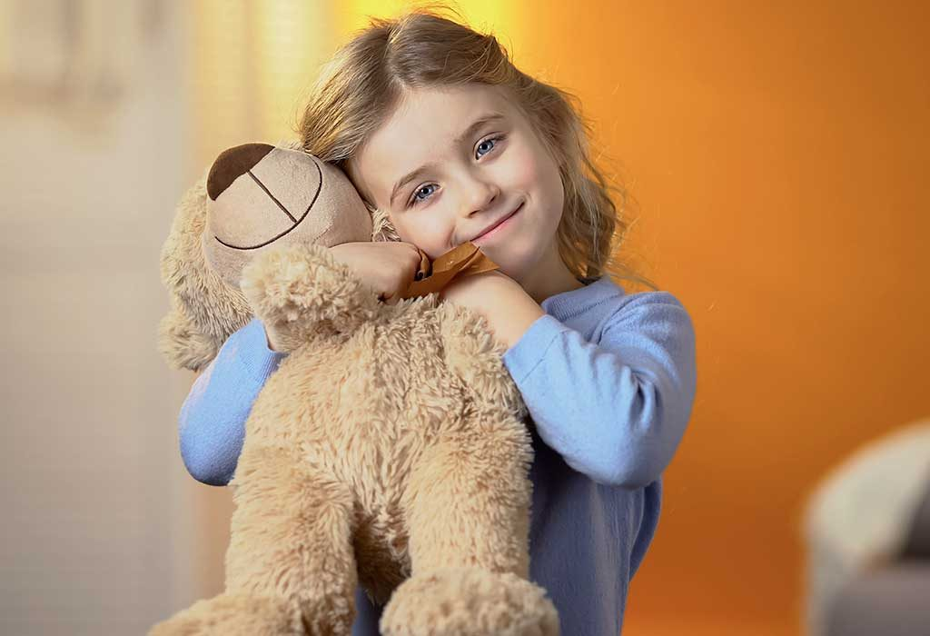 child holding favourite toy