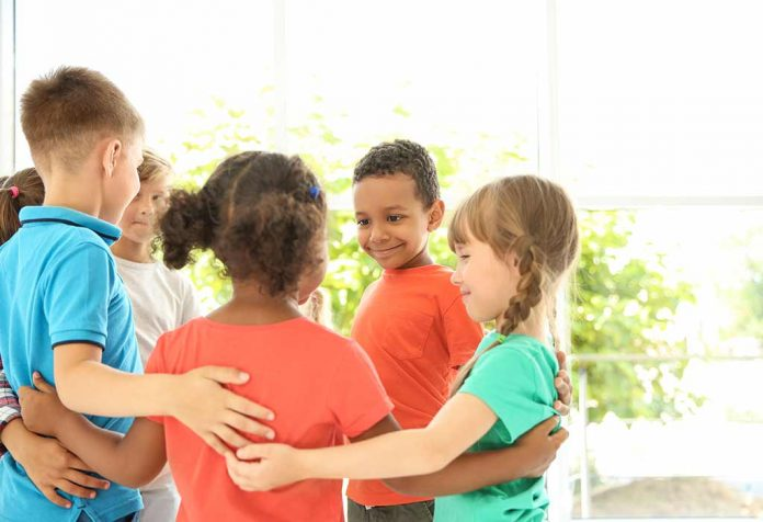 kids coming together for trust building exercise