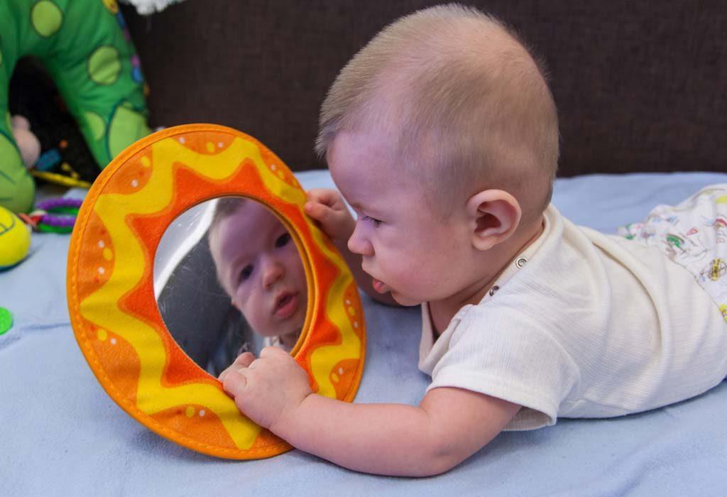 newborn with a mirror